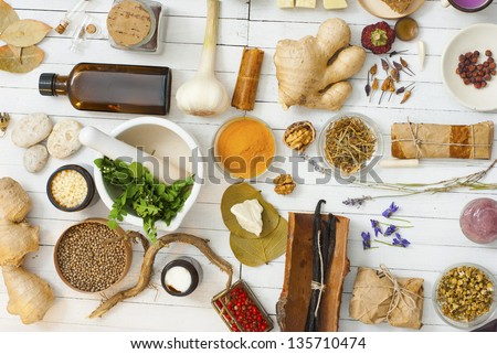 Herbs And Spices On White Wood Table