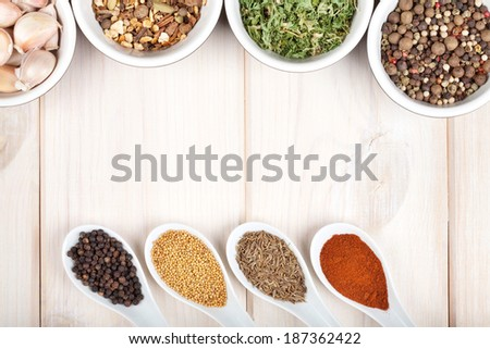 Herbs and spices on wood table background with copyspace