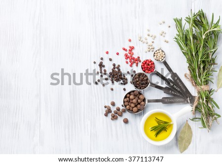 Herbs and spices over wood background. Top view with copy space