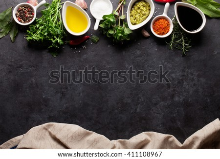 Herbs, condiments and spices on stone background. Top view with copy space #411108967