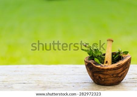 Herbs - Fresh herbs in a mortar