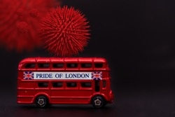 Herd Immunity.Concept of herd immunity. Uk London Bus pride of london with Coronavirus Covid-19 black background, Get sick and become immune to viruses. Spread of virus treatment through a vaccine.