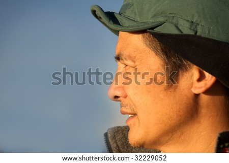 Here are a Chinese middle-aged man in the outdoor.