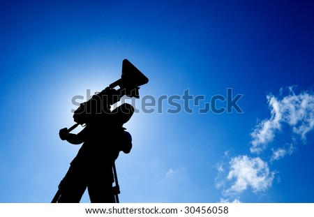 Here is a cameraman with silhouette photo.