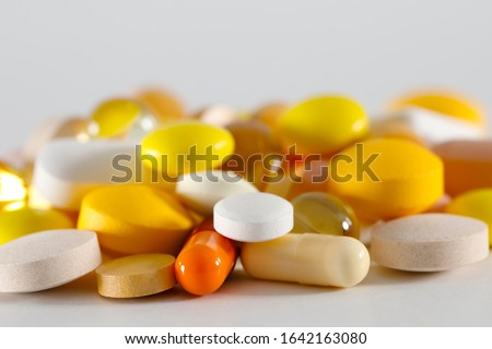 Here is a large dosage of medicines. These varied tablets have various shapes and various colors.