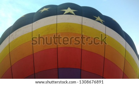 Here's a pic of a hot air balloon using the sky as a background...