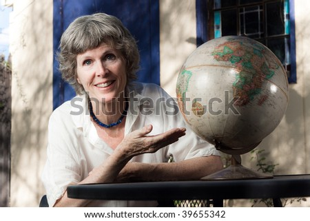 Here's the world - its at your fingertips - stock photo