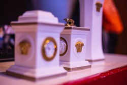 Here we see a collection of versace products of the Italian brand, vase, clock and lighter