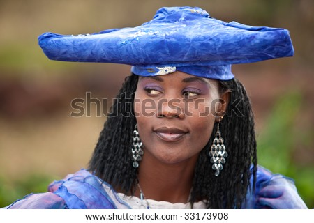 herero african girl with traditional clothing, hairstyle and jewelry, Namibia, South Africa, and Botswana