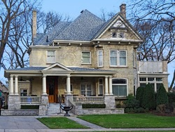 Heritage home with Victorian style detailing and large porch