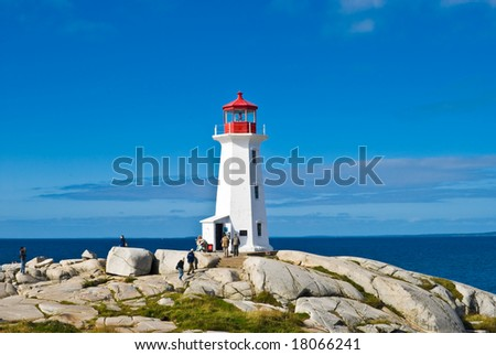 Heritage lighthouse on a rocky beach. Peggy's Cove, Canada. - stock photo