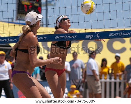 HERMOSA BEACH, CA. - AUGUST 8: Jen Kessy (L) and April Ross vs. Nicole Branagh (R) and Elaine Youngs for the womens final of the AVP Hermosa Beach Open. August 8, 2009 in Hermosa Beach. - stock photo