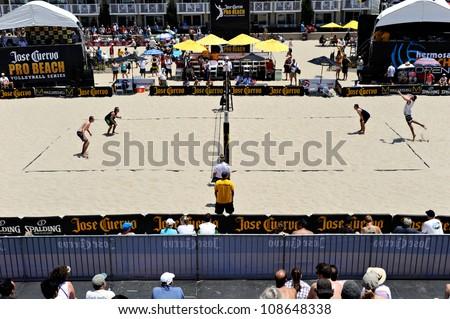 HERMOSA BEACH, CA - JULY 21: Brad Keenan, John Mayer, Mark van Zwieten and Andrew Fuller compete in the Jose Cuervo Pro Beach Volleyball tournament in Hermosa Beach, CA on July 21, 2012.