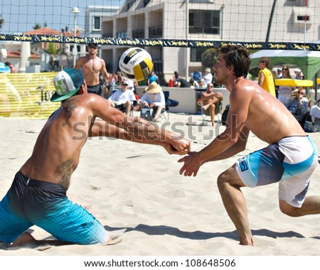 HERMOSA BEACH, CA - JULY 21: Derek Olson and Matt Motter compete in the Jose Cuervo Pro Beach Volleyball tournament in Hermosa Beach, CA on July 21, 2012.