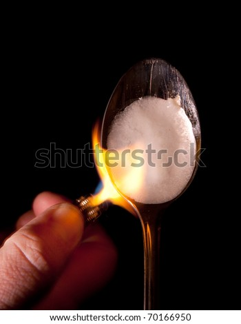 heroin or narcotic drug cook in spoon with lighter and flame. dangerous preparation of illegal substance - stock photo