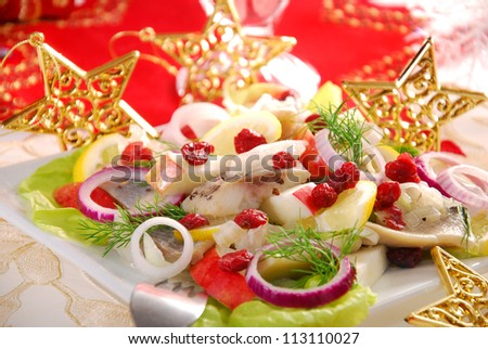 herring salad with apple,cranberry,lemon and dill for christmas