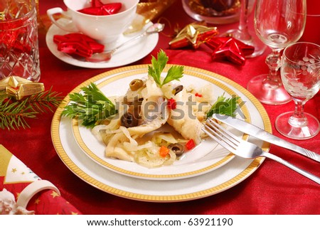 herring  salad with olives and onion on christmas table