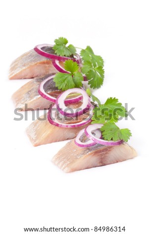 herring salt fillet with onion isolated pieces