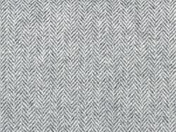 Herringbone tweed, Wool Background Texture. Coat close-up. Expensive men's suit fabric. Virgin wool extra-fine. High resolution.