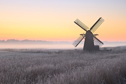 Herringfleet smock mill in the mist on a winter morning.