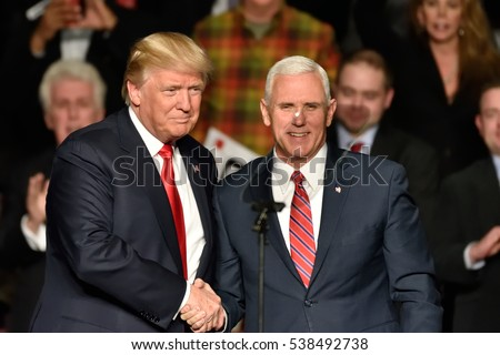 HERSHEY, PA - DECEMBER 15, 2016: President-Elect Donald Trump and Vice President-Elect Mike Pence shake hands on stage at a Thank You rally held at the Giant Center.
