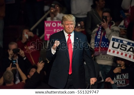 """HERSHEY, PA - DECEMBER 15, 2016: President-Elect Donald Trump gives a """"Fist Pump"""" to the crowd as he arrives on stage to deliver a speech at a """"Thank You"""" Tour rally at the Giant Center."""