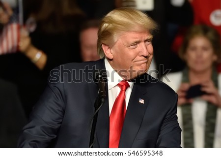 """HERSHEY, PA - DECEMBER 15, 2016: President-Elect Donald Trump looks left toward the crowd as he delivers a speech at a """"Thank You Tour"""" rally held at the Giant Center."""