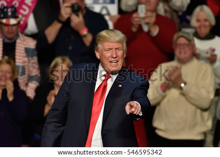 """HERSHEY, PA - DECEMBER 15, 2016: President-Elect Donald Trump points straight toward the crowd as he concludes his speech at a """"Thank You Tour"""" rally held at the Giant Center."""