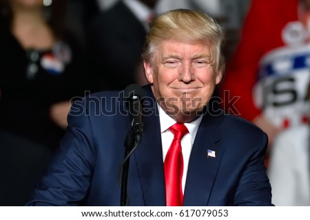 """HERSHEY, PA - DECEMBER 15, 2016: President Trump """"Cheshire cat"""" smile during his speech at a """"Thank You"""" Tour rally held at the Giant Center."""
