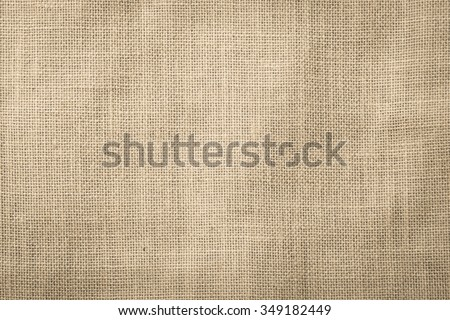 Hessian sackcloth woven texture pattern background in dark cream beige brown color tone: Eco friendly raw organic flax cloth fabric textile backdrop: Bag rope thread detailed textured burlap canvas