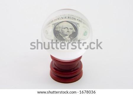 Het centrum van een één dollarrekening verschijnt in een kristalbal. - stock photo