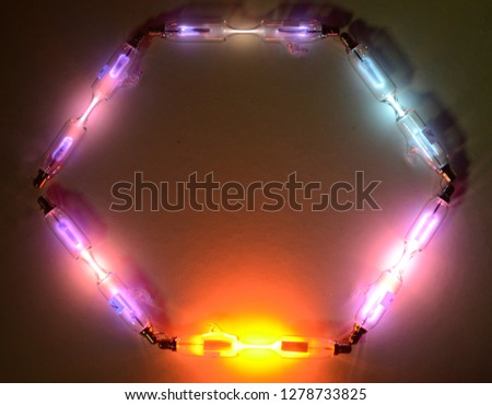 Hexagon of Geissler tubes with different gases.  #1278733825