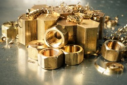 Hexagonal bars and brass products made on CNC metalworking machines. Manufacturing of parts from brass.
