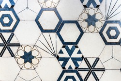 Hexagonal colorful modern bathroom, toilette or kitchen ceramic tiles wall. Artistic blue and white ornamental hexagonal ceramic tiles texture pattern for domestic indoor use.