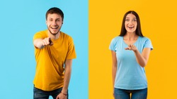 Hey, You. Portrait of cheerful casual couple pointing fingers at camera, standing isolated over yellow and blue studio background wall. Excited boyfriend and girlfriend choosing and indicating