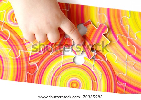 Hhild hand with puzzle