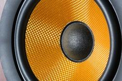 Hi-Fi audio system speaker membrane close-up.