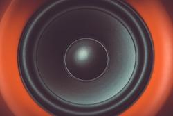 Hi-fi sound speaker box in closeup.Red speakerbox & black silk hifi tweeter with diffuser.Professional audio monitors for musician.Audio equipment for high quality music