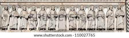 Hi-res closeup of the engraving of the Disciples of Christ on the 12th century Cathedral of St Martin in Lucca, Italy