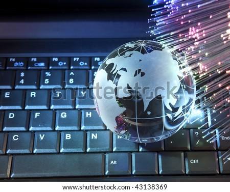 hi-tech earth globe against fiber optic background