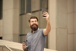 Hi there. Man taking selfie photo smartphone. Streaming online video call. Mobile internet. Tourist capture happy moment for blog. Hipster mobile phone blogger. Blog online content. Personal blog.