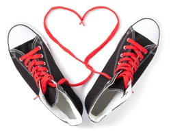 Hi-Top Black Sneakers with red laces heart on white. This file is cleaned, retouched and contains clipping path.