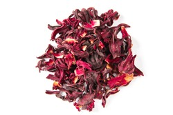 Hibiscus, a pile of red dried Hibiscus tea leaves. Karkade tea. On white background. View from above.