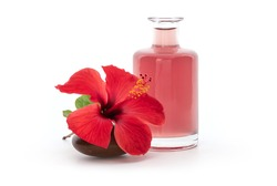 Hibiscus flower and water from dried petal isolated on white background.
