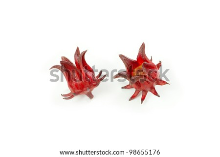 Hibiscus sabdariffa or roselle fruits on wood background