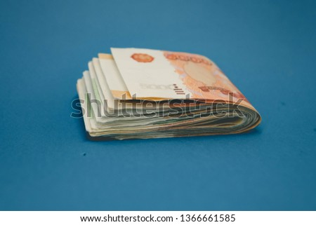 hick stack of cash money. The concept of rich, wealth, profits, business and finance. Five thousandth bills banknotes.