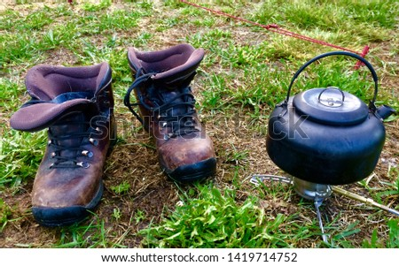 Hicking boots and coffee pot
