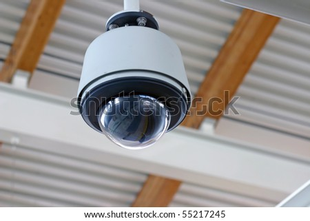 Hidden secure camera in a glass cover. - stock photo