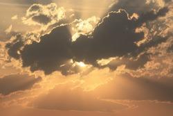 Hidden Sun Sunset behind the clouds