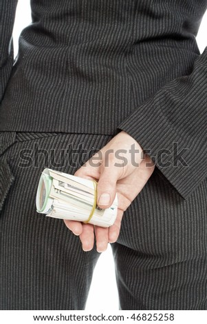 hide behind the money a woman in a suit (isolated on a white background)